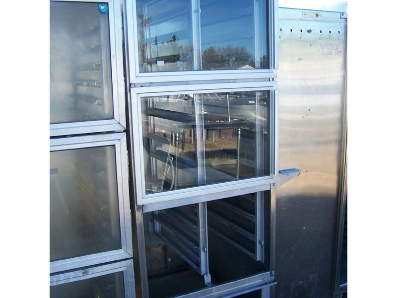 ENCLOSED HOLDING CABINET ON CASTERS W 3 GLASS DOORS 27 X 34 X 75
